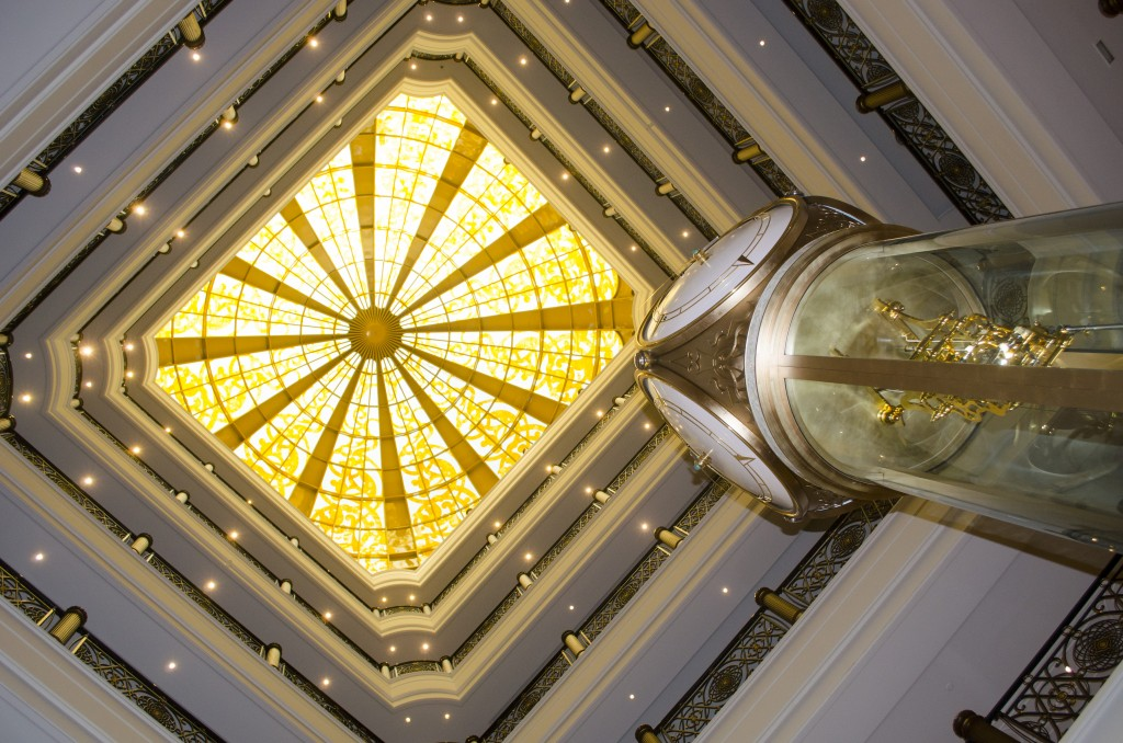 Foyer looking up to the stained glass dome ceiling. Notice the clock which is Islamic and gives the daily prayer times.