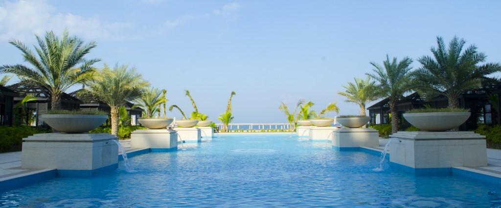 Numerous pools that spill onto the white sandy Ras al-Khaimah beach of the Arabian Gulf