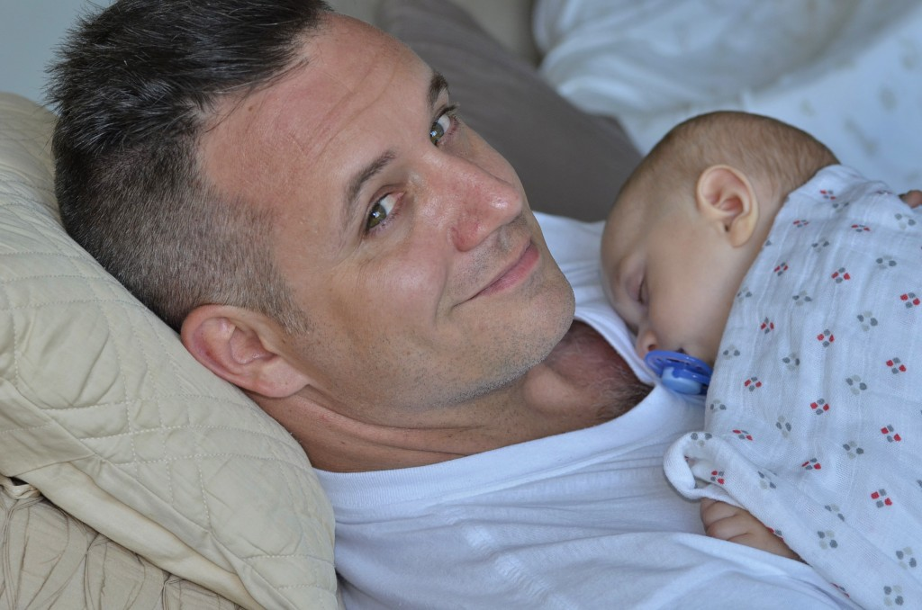 Our five month old - today! - sleeps on his dad's chest. Dubai, 7th May 2014.