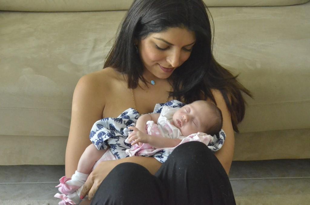Rio hugging baby Maya Hassan at Casa Hartley, June 2014