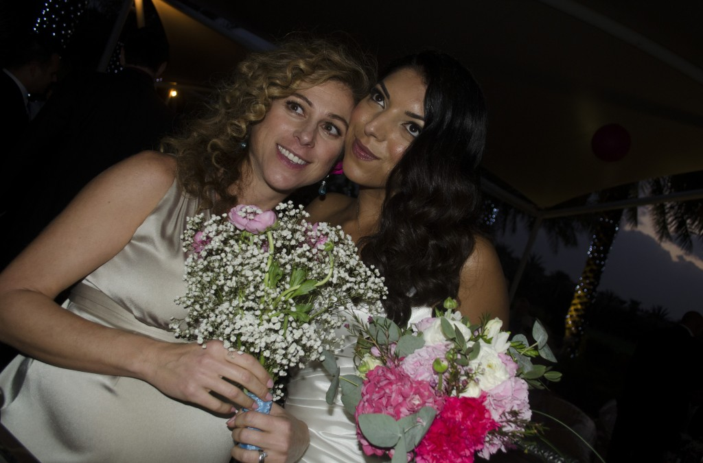 Playing bridesmaid to Rio at her wedding - and just a fortnight short of giving birth to Kingsley