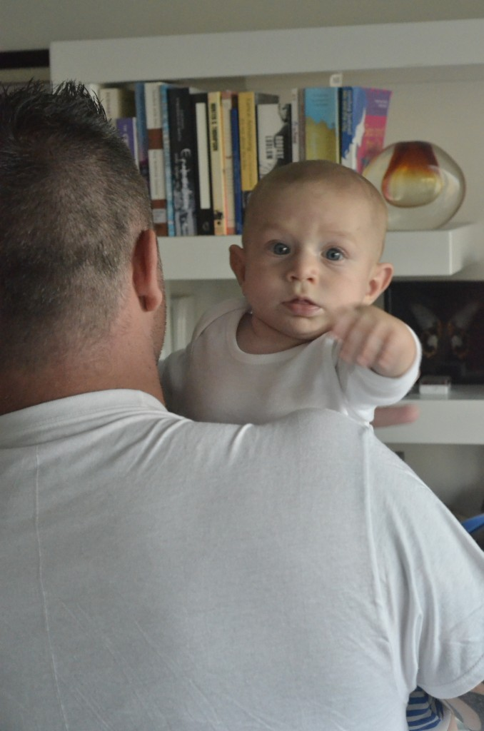 The King of games, with his dad at 5 months of age