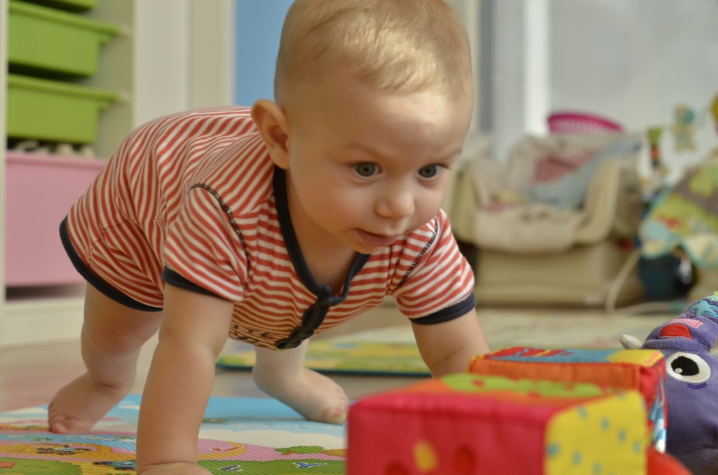 Learning to crawl and do push ups: at nursery