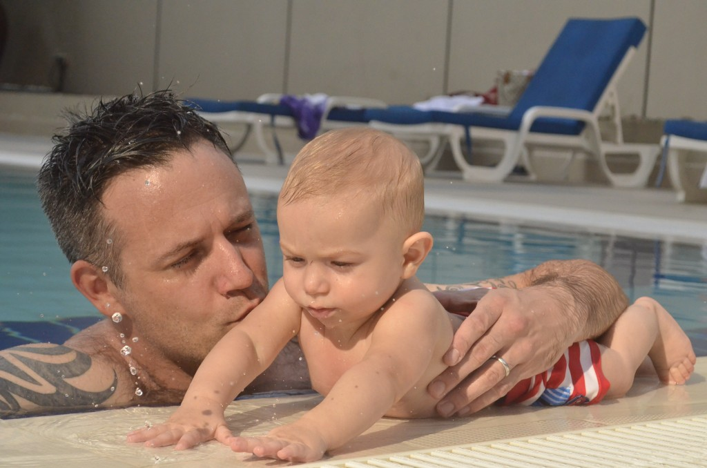 What I saw at the pool this afternoon: father and son totally loved up.